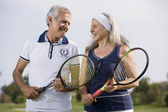 Senior couple playing tennis — Stock Photo