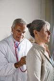 Doctor visiting senior woman — Stock Photo