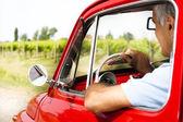 Senior man in vintage car — Stock Photo