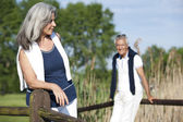 Senior couple on a footbridge — Stock Photo