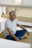 Senior man meditating — Stock Photo