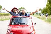Senior couple with vintage car — Stock Photo