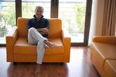 Senior man on a sofa — 图库照片