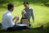 Colleagues having lunch break outdoors — Stock Photo