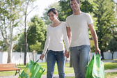 Young couple with reusable bags — Stock Photo