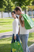 Young couple with reusable bags — Stockfoto
