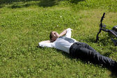 Businessman relaxing in a meadow — Stock Photo