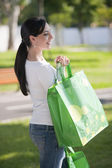 Young woman with reusable bags — Stockfoto