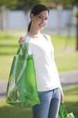 Young woman with reusable bags — Stock Photo