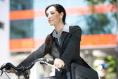 Beautiful businesswoman  biking — 图库照片