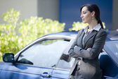 Businesswoman by her car — 图库照片