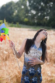 Young woman with windmill — 图库照片