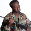 AfricAmericmwith gun — Stock Photo #24076063