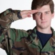 Young soldier saluting — Stock Photo