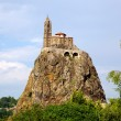 Ancient Chapelle Saint Michel de Aiguilhe standing at a very steep volcanic needle (Le Puy en Velay, France) — Stock Photo #18244067