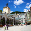 Tourists at hot springs colonnade in Karlovy Vary — Stock Photo #18245635