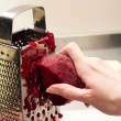 Grate beet by hand - Stock Photo