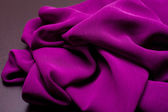 Purple, violet tender colored textile, elegance rippled material — Stock Photo