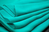 Blue, green, marine silk tender colored textile, elegance rippled material — Stock Photo