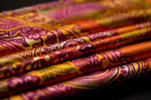 Red, yellow, orange tender colored textile, elegance rippled material — Stock Photo