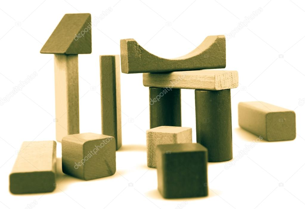 Wooden building blocks isolated on white background. — Stock Photo #13344029