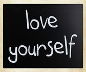 """Love yourself"" handwritten with white chalk on a blackboard — Stock Photo"