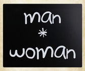 """Man-woman"" handwritten with white chalk on a blackboard — Stock Photo"
