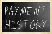 """""""Payment history"""" handwritten with white chalk on a blackboard — Stock Photo"""