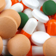 Stock Photo: Pills of many shapes and colors grouped together