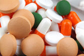 Pills of many shapes and colors grouped together — Stock Photo