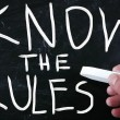 Royalty-Free Stock Photo: Know the rules handwritten with white chalk on a blackboard