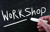 """Workshop"" handwritten with white chalk on a blackboard — Stock Photo"