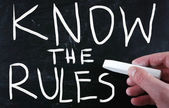 """""""Know the rules"""" handwritten with white chalk on a blackboard — Stock Photo"""
