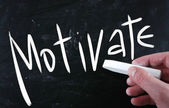 """Motivate"" handwritten with white chalk on a blackboard — Stock Photo"