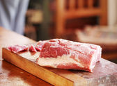 Raw pork on cutting board — Stock Photo