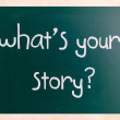 """What is your story"" handwritten with white chalk on a blackboar — Stock Photo #34734143"
