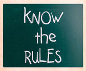 """Know the rules"" handwritten with white chalk on a blackboard — Stock Photo"