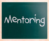 """The word """"Mentoring"""" handwritten with white chalk on a blackboar — Stock Photo"""
