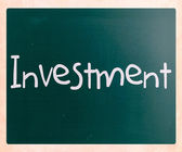 The word 'Investment' handwritten with white chalk on a blackboa — Stock Photo