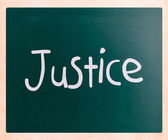 """""""Justice"""" handwritten with white chalk on a blackboard — Stock Photo"""