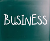 "The word ""Business"" handwritten with white chalk on a blackboard — Stock Photo"