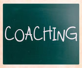 """Coaching"" handwritten with white chalk on a blackboard — Stok fotoğraf"