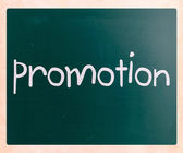 "The word ""promotion"" handwritten with white chalk on a blackboar — Stock Photo"