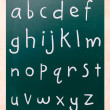 Complete english alphabet handwritten with white chalk on a blac — Foto de Stock