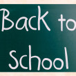 Back to school handwritten with white chalk on a blackboard — Stock Photo
