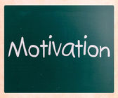 """Motivation"" handwritten with white chalk on a blackboard — Stock Photo"