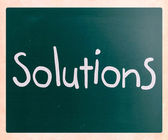 """Solutions"" handwritten with white chalk on a blackboard — Stok fotoğraf"