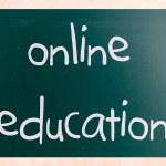 """Online education"" handwritten with white chalk on a blackboard — Stock Photo"