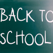 """Back to school"" handwritten with white chalk on a blackboard — Stock Photo #34783925"