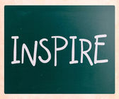 """Inspire"" handwritten with white chalk on a blackboard — Stock Photo"
